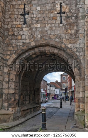 York, England - April 2018: Thoroughfare under Monk Bar, main gatehouses or bars of York City Walls, (Bar Walls or Roman walls), leading to old city of York, England, UK #1265766058