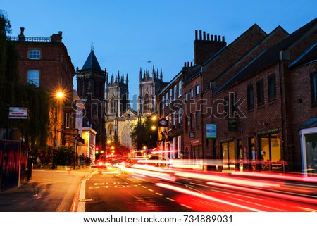 York, UK. Sundown of central York, UK, with York Minster cathedral on the back and blue cloudy sky. Car traffic trail lights in York, UK