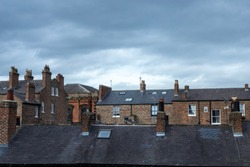 York, Yorkshire, England / UK - Old roofs and typical chimneys pots in York,