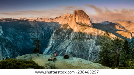 Yosemite Half dome from Glacier Viewpoint at sunset. A forest fire is present in the background