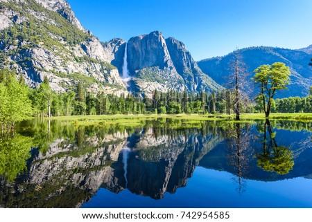Shutterstock Yosemite National Park - Reflection in Merced River of Yosemite waterfalls and beautiful mountain landscape, California, USA