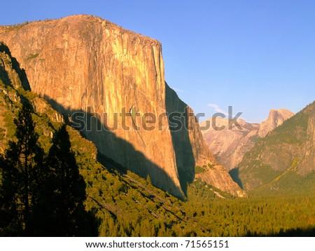 Yosemite's El Capitan glowing golden in setting sunlight