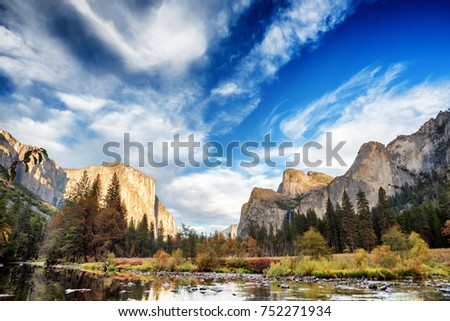 Yosemite Valley, as seen from Valley View scenic point, at the bank of the Merced River on an autumn day