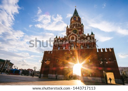 Yoshkar-Ola city, Republic of Mari El, Russia - May, 2019: View of the Spasskaya Tower on Bruges embankment in sunset rays #1443717113