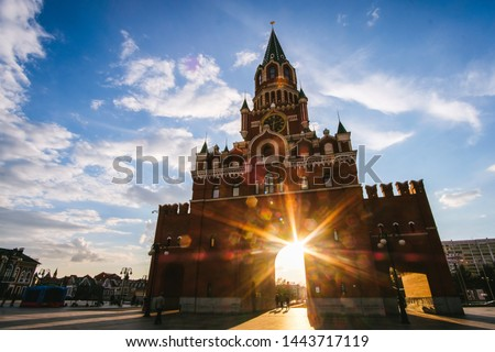 Yoshkar-Ola city, Republic of Mari El, Russia - May, 2019: View of the Spasskaya Tower on Bruges embankment in sunset rays #1443717119