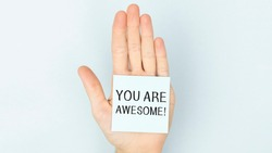 You Are Awesome. Motivational inspirational quotes words. Wooden background