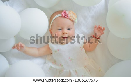 You are my little angel. Family. Child care. Childrens day. Childhood happiness. Sweet little baby. New life and birth. Small girl. Happy birthday. Portrait of happy little child in white balloons.
