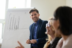 You are quite right! Smiling millennial man coach trainer team leader cheering encouraging teammate colleague trainee for good idea, correct answer, interesting comment on seminar project presentation