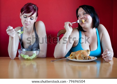 You are what you eat. Skinny woman eating a few leaves of lettuce