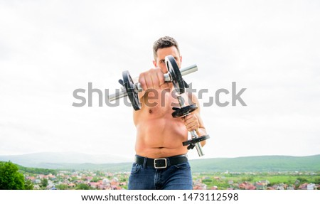 You can do it Muscular man exercising in morning with barbell. fitness and sport equipment. man sportsman with strong hands. steroids. athletic body. Dumbbell gym. success. Perfect biceps.