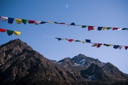 You can find these prayer flags all over Arunachal Pradesh but in front of a mountain and with the moon. It symbolises the power of nature