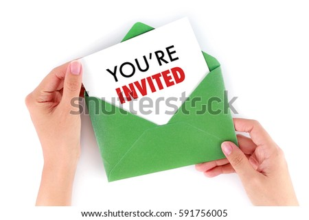 You're Invited Concepts - Hand holding a envelope and post card  #591756005