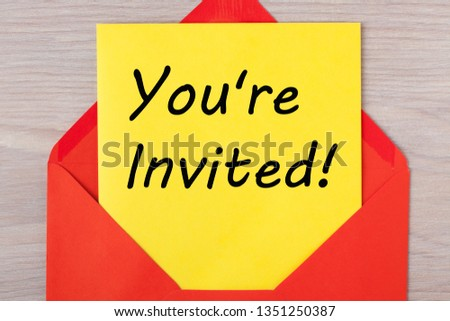 You're Invited message on letter in red envelope. #1351250387