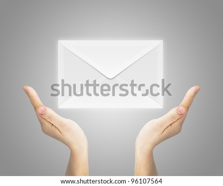 You've got mail envelope. Human hand serving mail icon on grey background