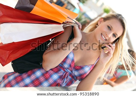 Youg busy woman shopping