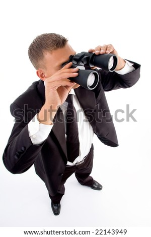 young accountant looking through binoculars on an isolated white background