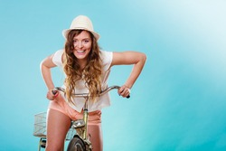 Young active woman girl riding bike bicycle. Healthy lifestyle and recreation leisure activity. Studio shot.