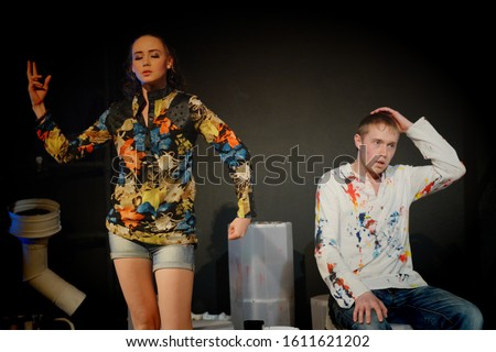 Young actor and young actress on the stage of the theater