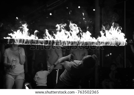 Young actors held a show of fire and sticks and chain fire at Sai Kaew Beach, Sabai, Rayong, Thailand on 25 November 2017. Nightlife is a stop. And shoot Of tourists #763502365