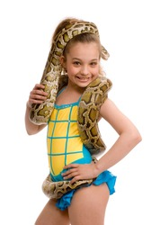 young adorable girl with pet python on her shoulders, isolated on white background