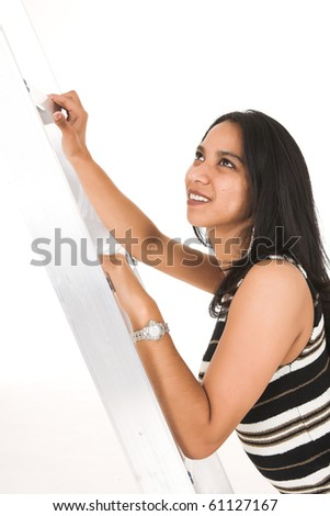 Young adult African-Indian businesswoman in casual office outfit Metaphorically climbing the ladder of success. Shot on a white backgroun, Not Isolated