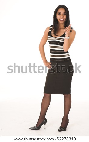 Young adult African-Indian businesswoman in casual office outfit with a black pencil skirt, a striped brown top and high heels on a white background. Not Isolated