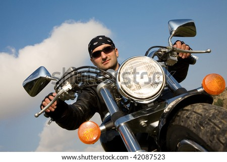 Young adult biker ready for a long road trip