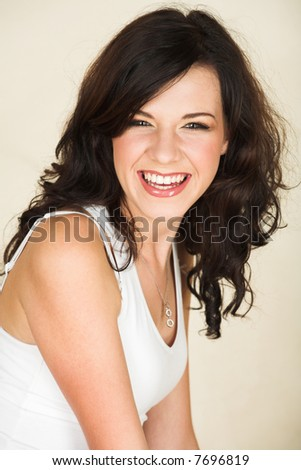 stock photo : Young adult brunette woman with a white top and long brown ...