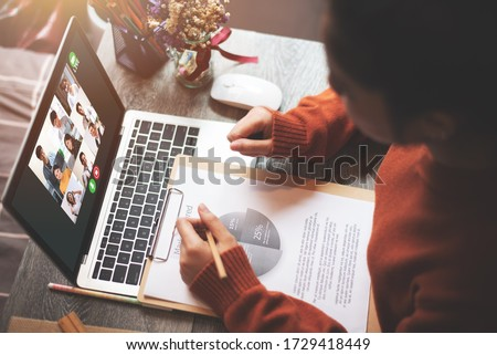 Young Adult Business Woman Online Meeting with Multiethnic Business People and VDO Conference Live Streaming in Teleconference - Work from Home Concept