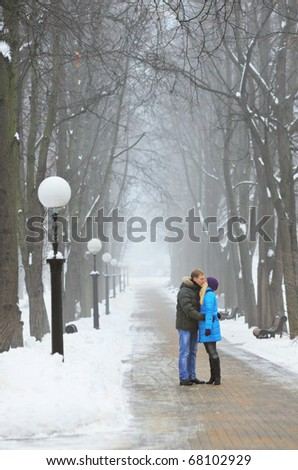 Young adult couple in the park. Winter.