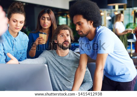 Young adult coworkers having arguments