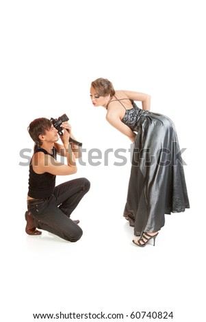stock photo : Young adult female Caucasian model being photographed in .