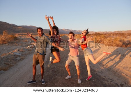 Young adult friends have fun striking poses in the desert #1243214863