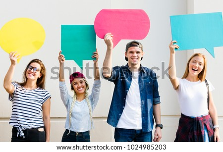 Young adult friends holding up copyspace placard thought bubbles