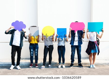 Young adult friends holding up copyspace placard thought bubbles #1036620589