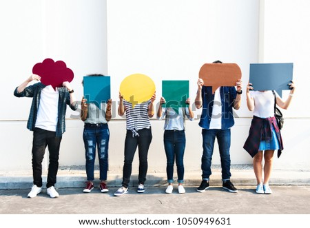 Young adult friends holding up copyspace placard thought bubbles #1050949631