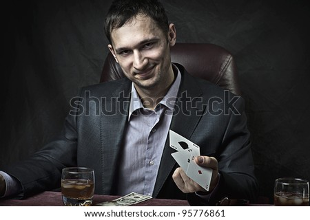 Young adult handsome business man winner playing poker