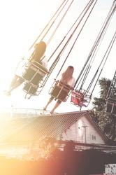 Young adult having fun at funfair. Amusement park. Nostalgic. Summer vacation