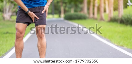 Young adult male with muscle pain during running. runner have leg ache due to Groin Pull. Sports injuries and medical concept