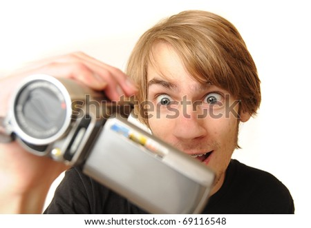Young adult man holding a camcorder isolated on white background