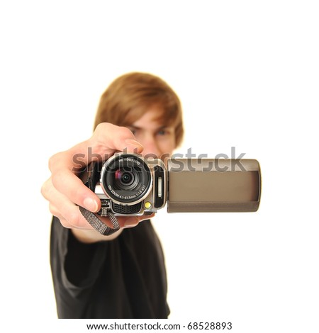 Young adult man holding a camcorder isolated on white background. This image works great for demonstrating the power of Online Video. - stock photo