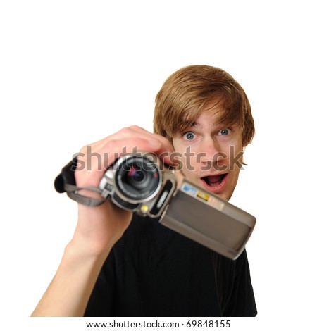 Young adult man holding an HD camcorder isolated on white background