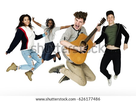 Young Adult People Jumping with Guitar Studio Portrait #626177486
