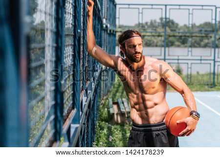 Young adult street basketball player at basketball court