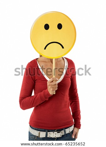 young adult woman holding sad emoticon on white background. Vertical shape, waist up
