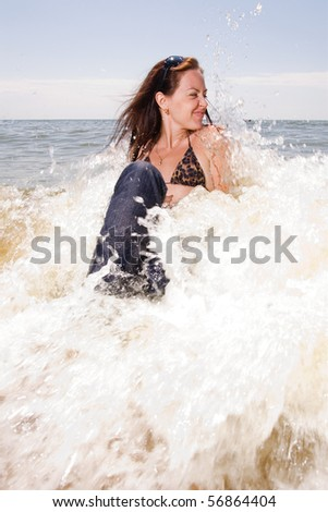 stock photo young adult woman in wet jeans sits in splashes of tidal waves of a sea smiling 56864404 TripAdvisor Reviews of Olimpo Court Hotel San Juan