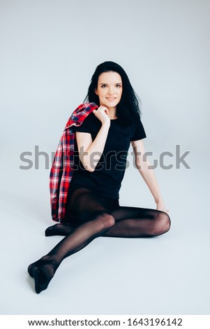 Young adult woman posing wearing total black. Casual outfit.Ballerina style.