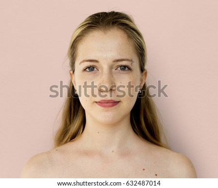 Young Adult Woman Serene Face Expression Studio Portrait #632487014