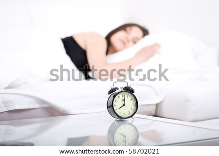 young adult woman sleeping in bed