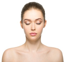 Young adult woman with beautiful face, clean healthy skin - isolated on white. Skin care concept. Closed eyes.